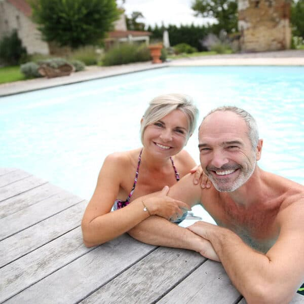Older couple exercise pool